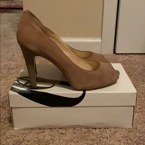 Beige sued Nine West heels.